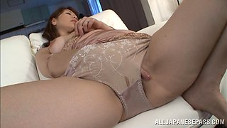 A Japanese mature babe soaks through her panties while fingering