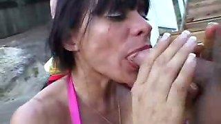 Sexy woman in bikini like the feeling of a cock in her mouth