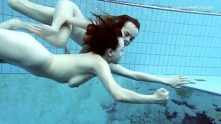 Two Horny dressed beauties underwater Netrebko and Poleshuk