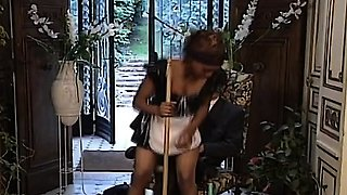 African slut in maid uniform caught in an interracial