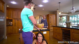 Black-haired cougar with large breasts getting screwed in the kitchen