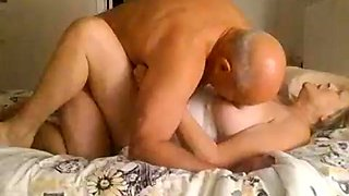 Busty blonde granny gets nailed missionary style on the bed