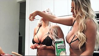 Two big breasted milfs in lingerie have fun in the kitchen