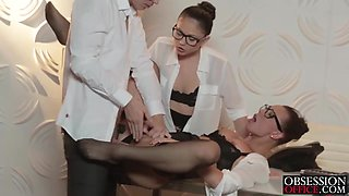 Horny boss have fun with two hot secretaries in the office