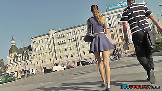 Amateur redhead shows sexy legs in candid upskirts