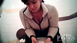 Busty MILF pissing in the toilet on the hidden camera