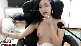 Korean babe smoking and masturbating