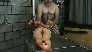 Asian slave does a blowjob