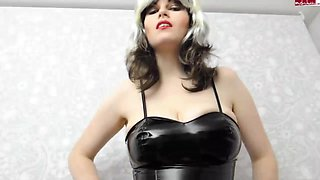Busty blonde dominatrix in leather skirt shows off