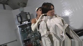Latex mistress plays with her 2 slaves in rubber
