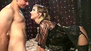 Mistress in stockings uses strapon and fist to satisfy submissive