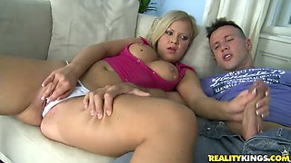 Sunny Diamond masturbates her shaved pussy and plays with big cock at the same time