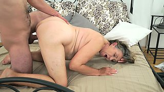 Granny's hairy peach is pounded by young dick