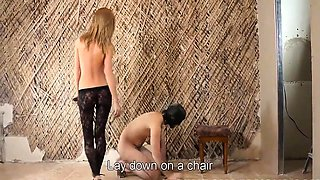 Dominant blonde in lingerie teases and punishes her slave