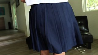 Schoolgirl Marica walks through the house before