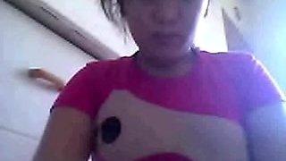 Cute Filipina woman flashing her perky breasts on web camera