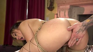 Beautiful brunette chick experiences a kinky bondage sex