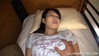 Horny chic wakes up in the night to enjoy the feeling of having her cooter fingered