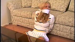 Cheerleader surprise bondage