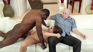 Kayla West is sucking a big, black meat stick in front of her husband, just for fun