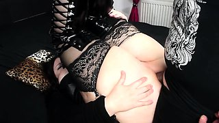 Voluptuous brunette in latex takes a hard shaft up her ass