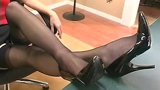 Naughty secretary is fucking herself on the table of her boss