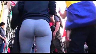 Street voyeur follows a hot amateur babe with a perfect ass