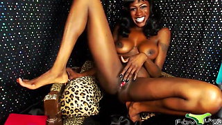 Ebony mistress Miss DarkNess with a pink gushing vagina