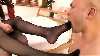 Two sexy Japanese schoolgirls dominate a guy with their feet