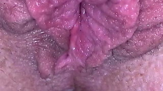 Milf plays with huge pierced clit