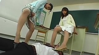 Naughty Japanese dominatrices in hot action