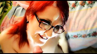 Cute redhead with glasses takes a hot cumload on her face