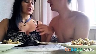 Russian mature mom with her boy in the kitchen