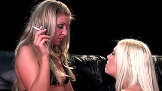Mistress dominates her blonde slave with smoke