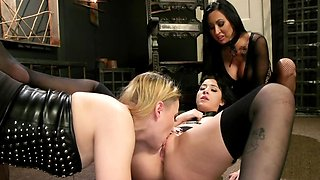 Dominant ladies with strapons stuff brunette's holes at once