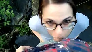 Nerdy girl in glasses sucks cock and eats semen outdoors