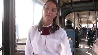 Pretty teen does blowjob on Japanese bus