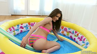 Filthy teen Rebel Lynn oils up her body for crazy sex in the inflatable pool