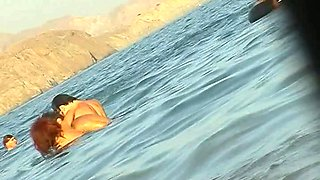 Ladies on the nudist beach exposed to the hidden cam