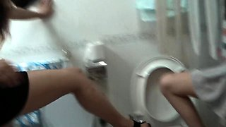 Dominant Japanese lady punishing her slave in the toilet